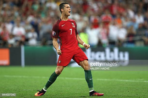 Portugal's forward Cristiano Ronaldo celebrates after scoring a penalty during the Euro 2016 quarterfinal football match between Poland and Portugal...