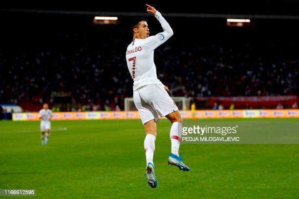Portugal's forward Cristiano Ronaldo celebrates after scoring during the EURO 2020 football qualification match between Serbia and Portugal in...