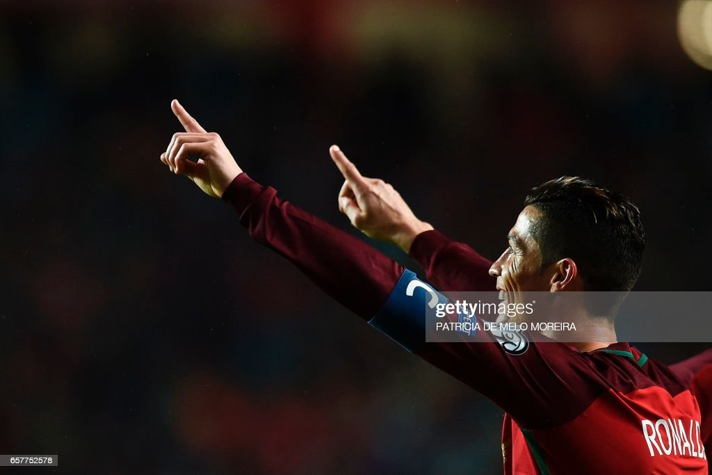 Portugal's forward Cristiano Ronaldo celebrates after scoring during the WC 2018 group B football qualifing match Portugal vs Hungary at the Luz stadium in Lisbon on March 25, 2017. /