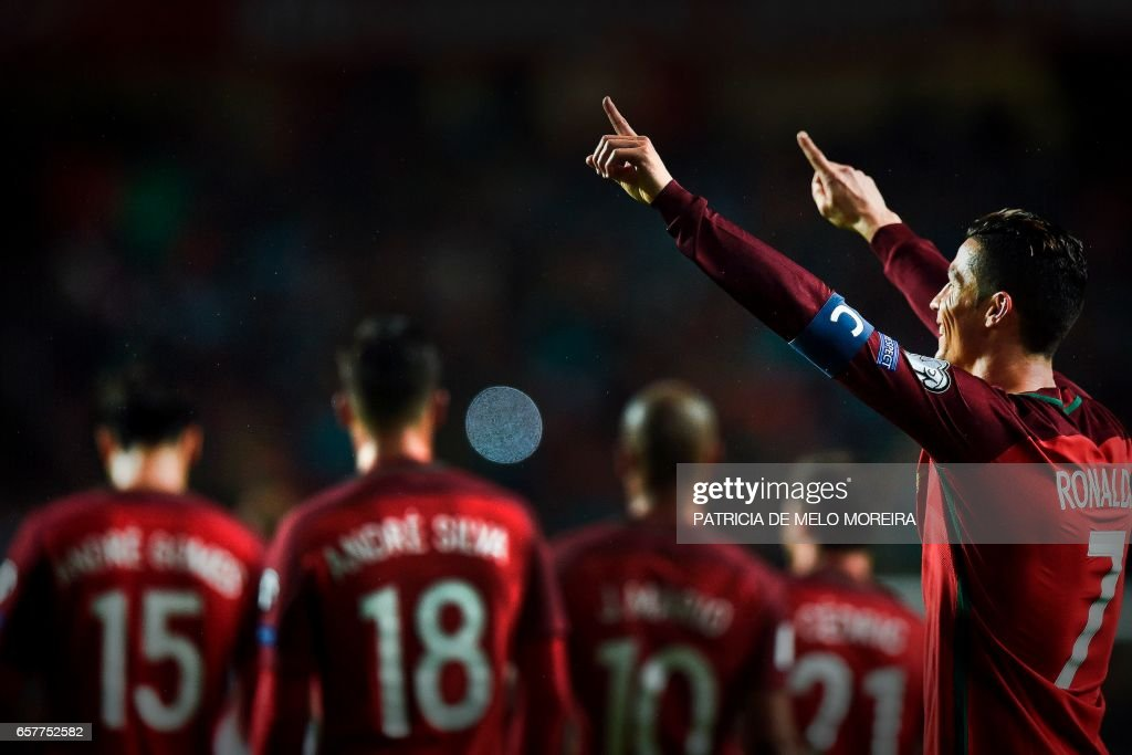 Portugal's forward Cristiano Ronaldo celebrates after scoring during the WC 2018 group B football qualifing match Portugal vs Hungary at the Luz stadium in Lisbon on March 25, 2017. MOREIRA