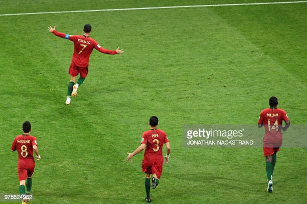 TOPSHOT Portugal's forward Cristiano Ronaldo celebrates after scoring his third goal during the Russia 2018 World Cup Group B football match between...
