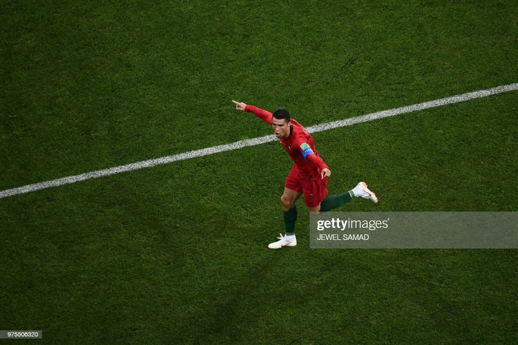 TOPSHOT - Portugal's forward Cristiano Ronaldo celebrates after scoring the second goal during the Russia 2018 World Cup Group B football match between Portugal and Spain at the Fisht Stadium in Sochi on June 15, 2018. (Photo by Jewel SAMAD / AFP) / RESTRICTED