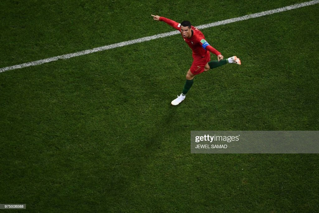 Portugal's forward Cristiano Ronaldo celebrates after scoring the second goal during the Russia 2018 World Cup Group B football match between Portugal and Spain at the Fisht Stadium in Sochi on June 15, 2018. (Photo by Jewel SAMAD / AFP) / RESTRICTED