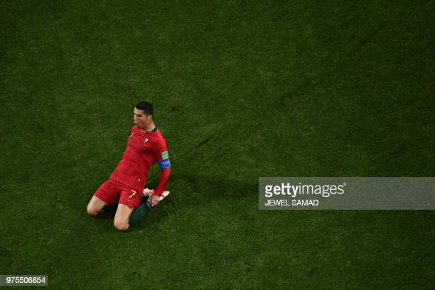 TOPSHOT Portugal's forward Cristiano Ronaldo celebrates after scoring the second goal during the Russia 2018 World Cup Group B football match between...