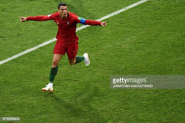 Portugal's forward Cristiano Ronaldo celebrates after scoring the second goal during the Russia 2018 World Cup Group B football match between...