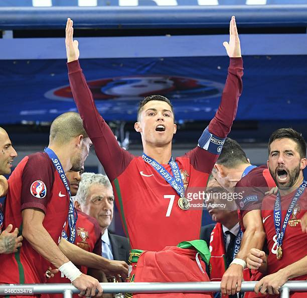 Portugal's forward Cristiano Ronaldo celebrates as he poses after Portugal won the Euro 2016 final football match between Portugal and France at the...