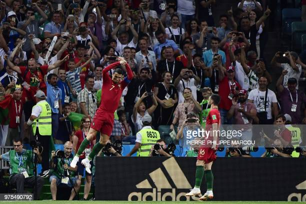 Portugal's forward Cristiano Ronaldo celebrates his goal during the Russia 2018 World Cup Group B football match between Portugal and Spain at the...