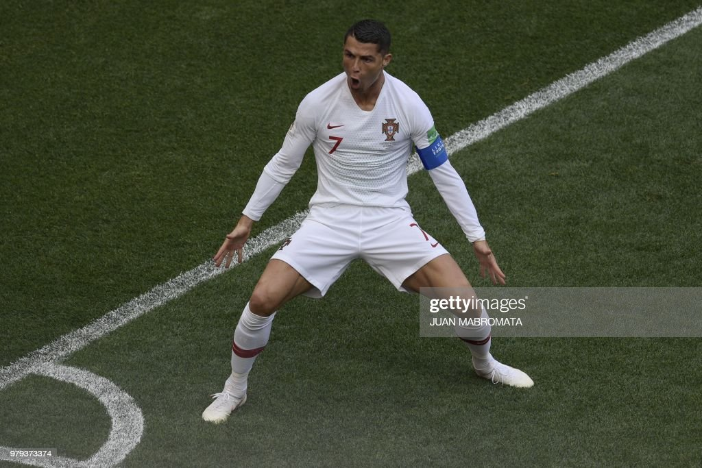 TOPSHOT - Portugal's forward Cristiano Ronaldo celebrates his opening goal for Portugal during the Russia 2018 World Cup Group B football match between Portugal and Morocco at the Luzhniki Stadium in Moscow on June 20, 2018. (Photo by Juan Mabromata / AFP) / RESTRICTED