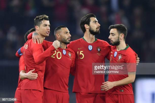 Portugal's forward Cristiano Ronaldo celebrates his second goal with teammates forward Ricardo Quaresma midfielder Andre Gomes and midfielder Bruno...