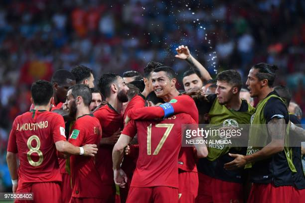 TOPSHOT Portugal's forward Cristiano Ronaldo celebrates his second goal with teammates during the Russia 2018 World Cup Group B football match...