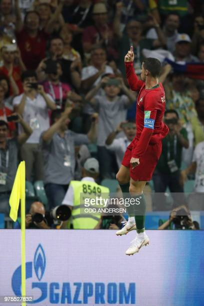 Portugal's forward Cristiano Ronaldo celebrates his third goal during the Russia 2018 World Cup Group B football match between Portugal and Spain at...