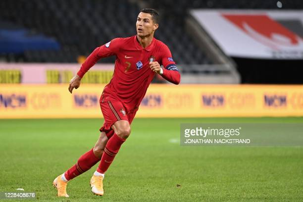 Portugal's forward Cristiano Ronaldo celebrates scoring his 100th goal for Portugal during the UEFA Nations League football match between Sweden and...