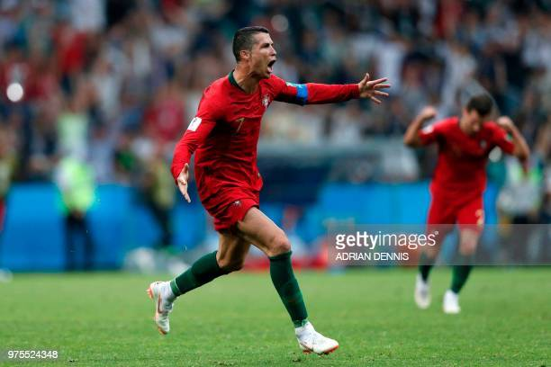 Portugal's forward Cristiano Ronaldo celebrates scoring his hattrick during the Russia 2018 World Cup Group B football match between Portugal and...