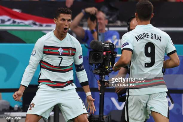 Portugal's forward Cristiano Ronaldo celebrates scoring his team's second goal during the UEFA EURO 2020 Group F football match between Hungary and...
