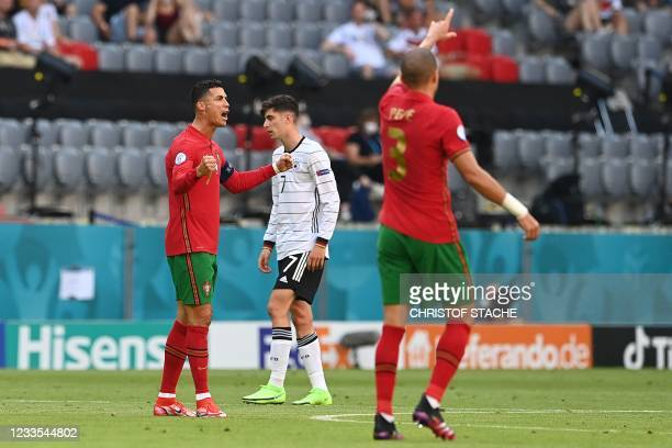 Portugal's forward Cristiano Ronaldo celebrates scoring his team's first goal during the UEFA EURO 2020 Group F football match between Portugal and...