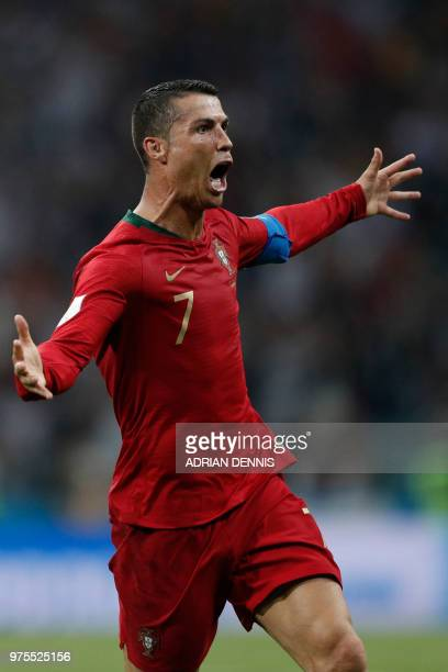 Portugal's forward Cristiano Ronaldo celebrates scoring his third goal during the Russia 2018 World Cup Group B football match between Portugal and...