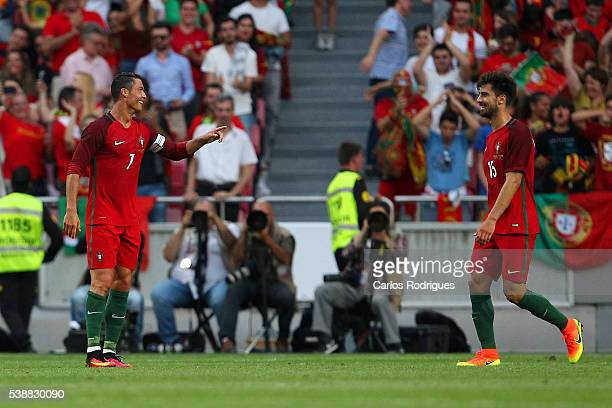 Portugal's forward Cristiano Ronaldo celebrates scoring Portugals third goal with Portugal's midfielder Andre Gomes during the International Friendly...