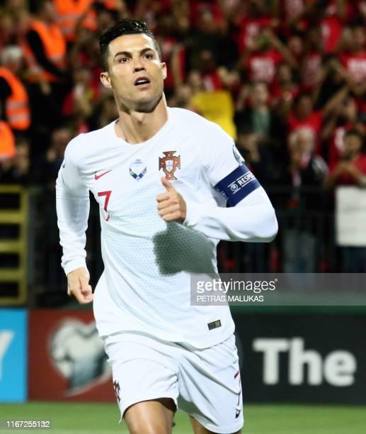 Portugal's forward Cristiano Ronaldo celebrates scoring the opening goal during the UEFA Euro 2020 Group B qualification football match Lithuania v...