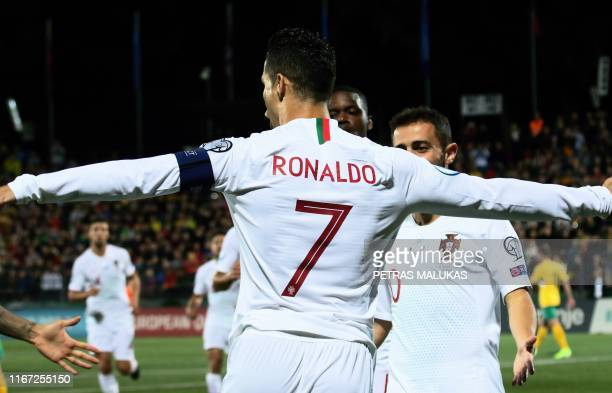 Portugal's forward Cristiano Ronaldo celebrates scoring the opening goal with his teammates during the UEFA Euro 2020 Group B qualification football...