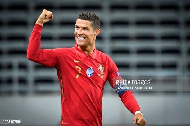 Portugal's forward Cristiano Ronaldo celebrates scoring the opening goal, his 100th goal for Portugal, during the UEFA Nations League football match...