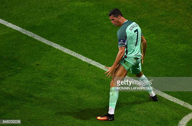TOPSHOT Portugal's forward Cristiano Ronaldo celebrates scoring the opening goal during the Euro 2016 semifinal football match between Portugal and...