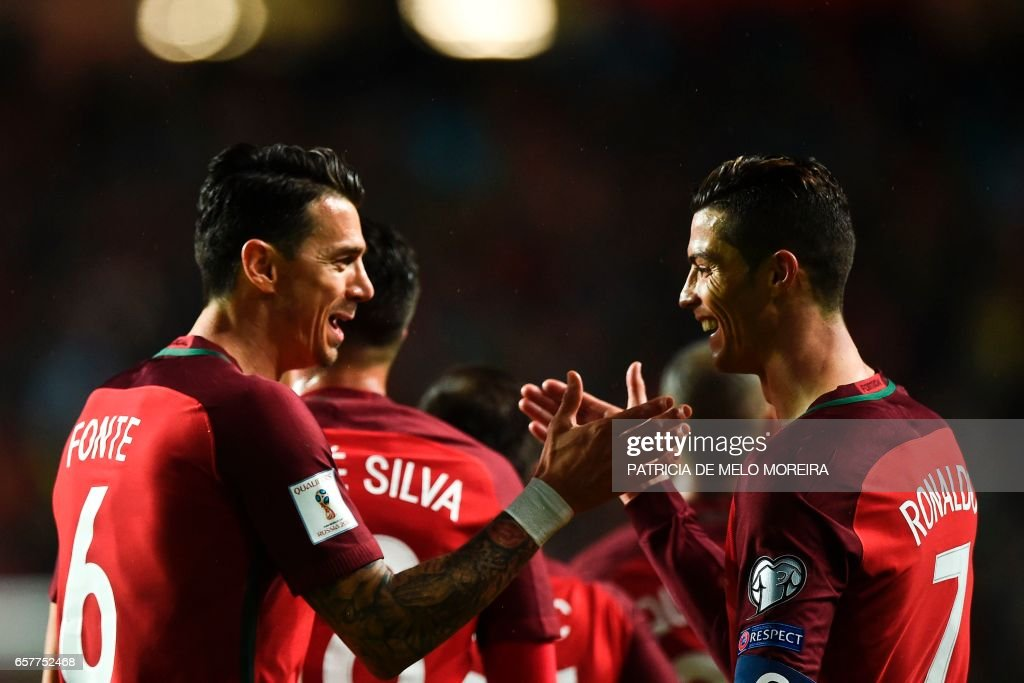 Portugal's forward Cristiano Ronaldo (R) celebrates with his teammate Portugal's defender Joao Fonte (L) after scoring during the WC 2018 group B football qualifing match Portugal vs Hungary at the Luz stadium in Lisbon on March 25, 2017. /