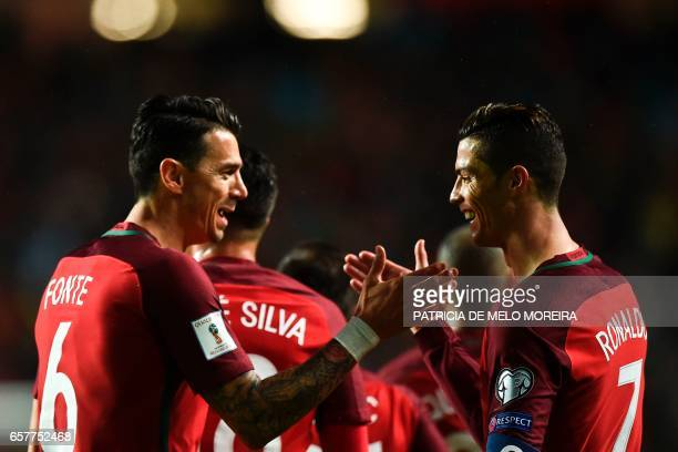 Portugal's forward Cristiano Ronaldo celebrates with his teammate Portugal's defender Joao Fonte after scoring during the WC 2018 group B football...