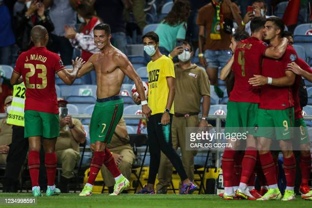 Portugal's forward Cristiano Ronaldo celebrates with his teammates after scoring a goal during the FIFA World Cup Qatar 2022 European qualifying...