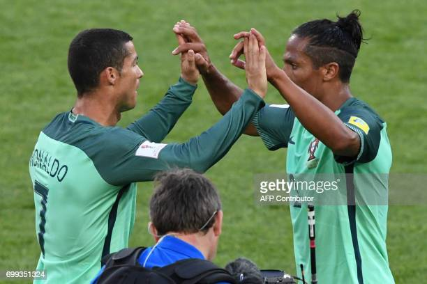 Portugal's forward Cristiano Ronaldo celebrates with Portugal's defender Bruno Alves after winning their 2017 Confederations Cup group A football...