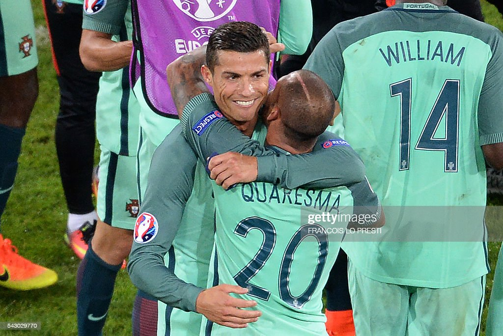 Portugal's forward Cristiano Ronaldo (L) celebrates with Portugal's forward Ricardo Quaresma at the end of the Euro 2016 round of sixteen football match Croatia vs Portugal, on June 25, 2016 at the Bollaert-Delelis stadium in Lens. / AFP / FRANCOIS