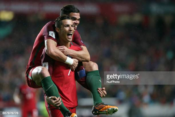 Portugal's forward Cristiano Ronaldo celebrates with Portugal's defender Pepe after scoring a goal during the FIFA World Cup Russia 2018 qualifier...