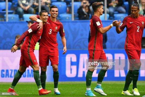 Portugal's forward Cristiano Ronaldo celebrates with Portugal's defender Pepe after scoring a penalty during the 2017 Confederations Cup group A...