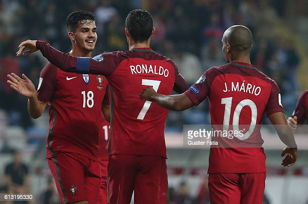 Portugal's forward Cristiano Ronaldo celebrates with teammate Portugal's forward Andre Silva after scoring a goal during the FIFA 2018 World Cup...
