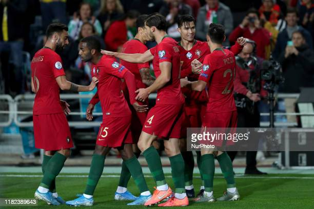 Portugal's forward Cristiano Ronaldo celebrates with teammates after scoring during the UEFA Euro 2020 Group B football qualification match between...