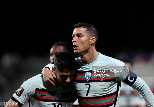 Portugal's forward Cristiano Ronaldo celebrates with teammates after scoring a goal during the FIFA World Cup Qatar 2022 qualification Group A...