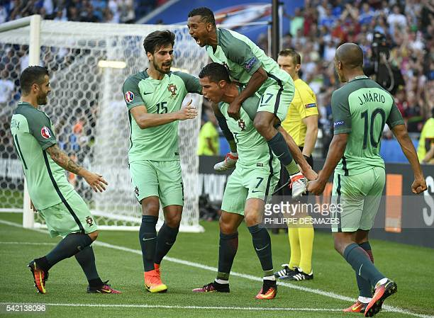 Portugal's forward Cristiano Ronaldo celebrates with teammates after scoring his team's second goal during the Euro 2016 group F football match...