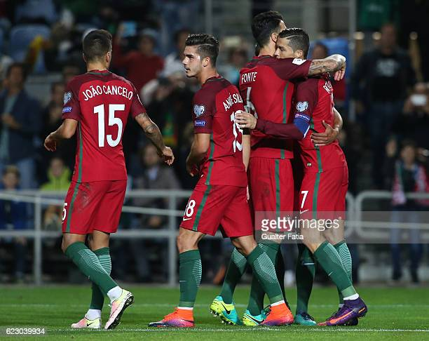 Portugal's forward Cristiano Ronaldo celebrates with teammates after scoring a goal during the FIFA 2018 World Cup Qualifier match between Portugal...