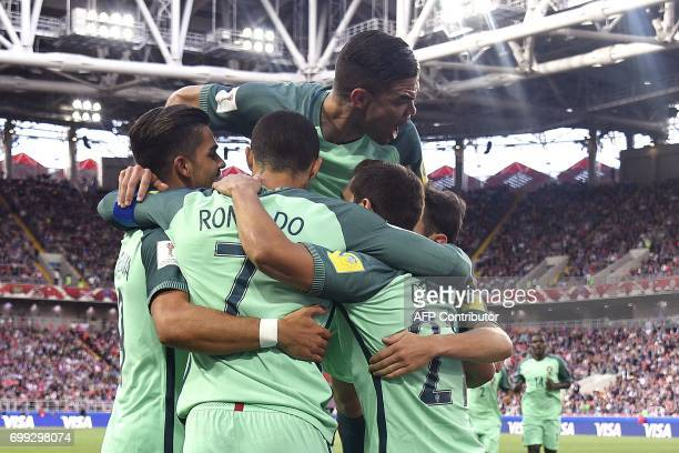 Portugal's forward Cristiano Ronaldo celebrates with teammates after scoring a goal during the 2017 Confederations Cup group A football match between...
