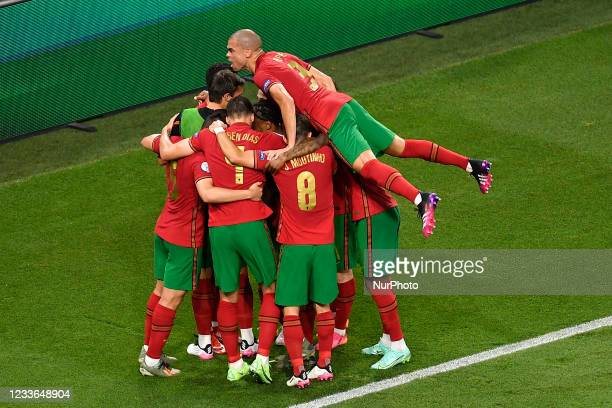 Portugal's forward Cristiano Ronaldo celebrates with teammates Pepe, Renato Sanchez and others after scoring the opening goal from the penalty spot...