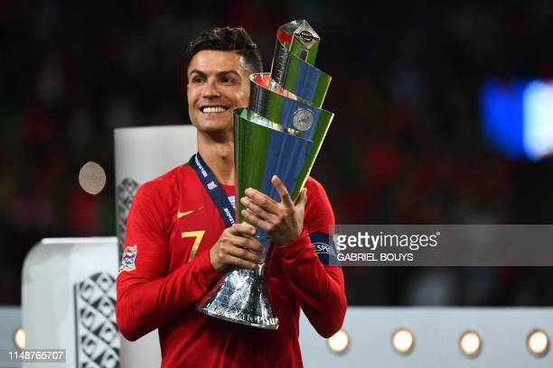 Portugal's forward Cristiano Ronaldo celebrates with the trophy after the UEFA Nations League final football match between Portugal and The...