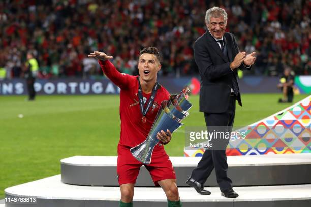 Portugal's forward Cristiano Ronaldo celebrates with the trophy after winning the UEFA Nations League Final football match between Portugal and...