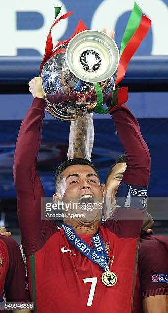 Portugal's forward Cristiano Ronaldo celebrates with the trophy as he poses after Portugal won the Euro 2016 final football match between Portugal...