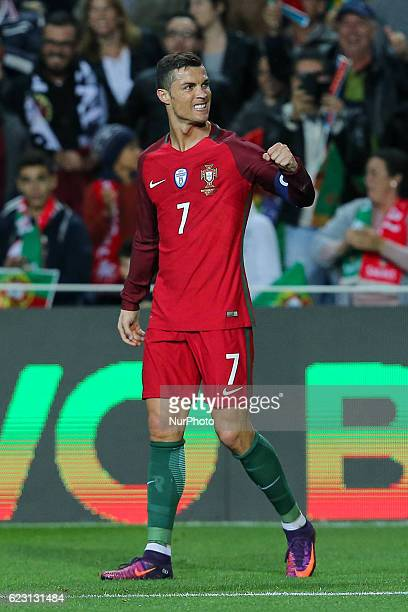 Portugals forward Cristiano Ronaldo celebrating after scoring third goal of the match during the 2018 FIFA World Cup Qualifiers matches between...