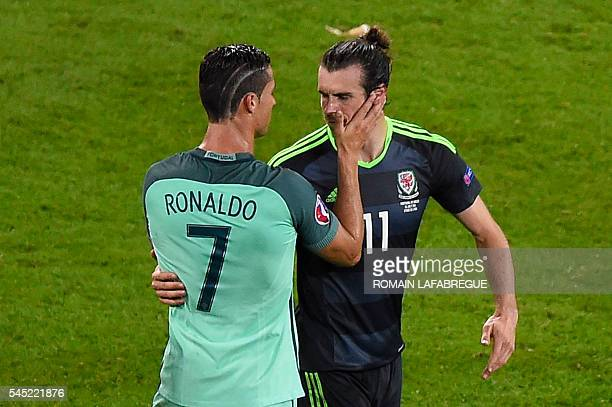 TOPSHOT Portugal's forward Cristiano Ronaldo comforts Wales' forward Gareth Bale after the Euro 2016 semifinal football match between Portugal and...