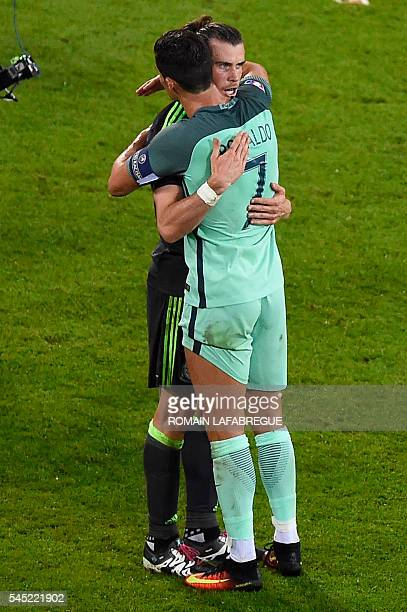 Portugal's forward Cristiano Ronaldo comforts Wales' forward Gareth Bale after the Euro 2016 semifinal football match between Portugal and Wales at...