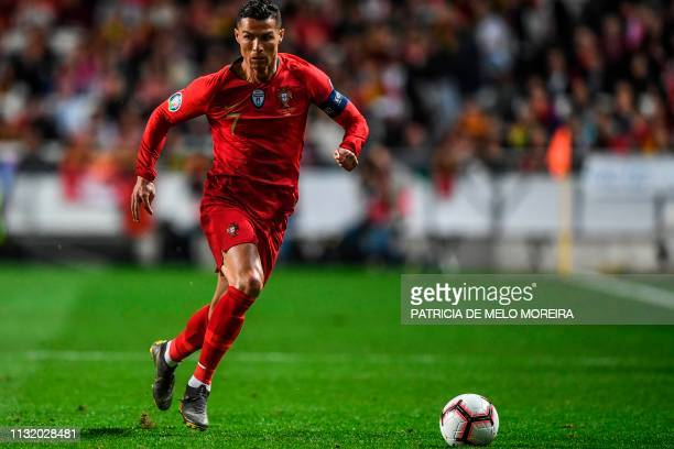 Portugal's forward Cristiano Ronaldo controls the ball during the Euro 2020 qualifying football match Portugal vs Ukraine at Luz stadium in Lisbon on...