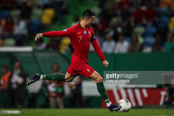 Portugal's forward Cristiano Ronaldo controls the ball during the Euro 2020 qualifier football match between Portugal and Luxembourg at the Jose...