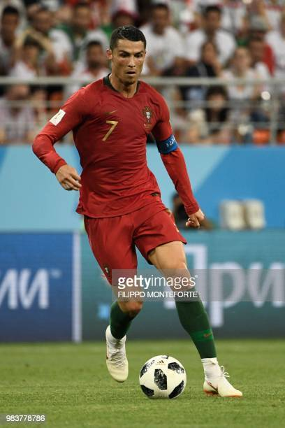 Portugal's forward Cristiano Ronaldo controls the ball during the Russia 2018 World Cup Group B football match between Iran and Portugal at the...