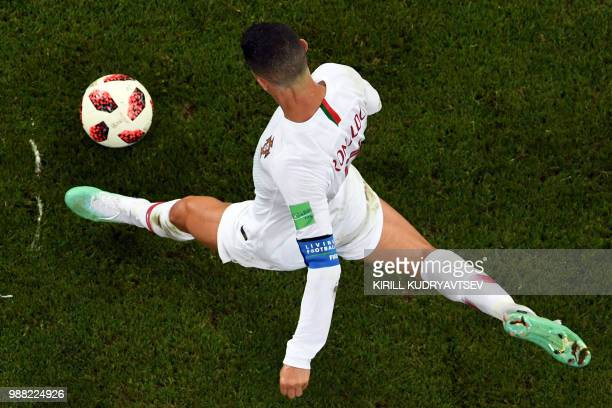 TOPSHOT Portugal's forward Cristiano Ronaldo controls the ball during the Russia 2018 World Cup round of 16 football match between Uruguay and...