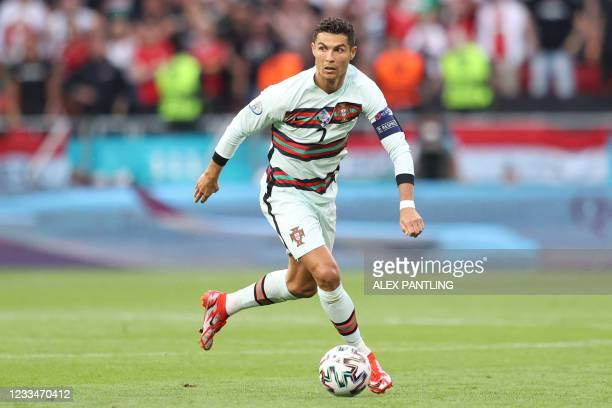 Portugal's forward Cristiano Ronaldo controls the ball during the UEFA EURO 2020 Group F football match between Hungary and Portugal at the Puskas...
